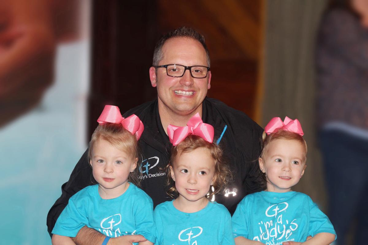 Ryan Smith with triplets