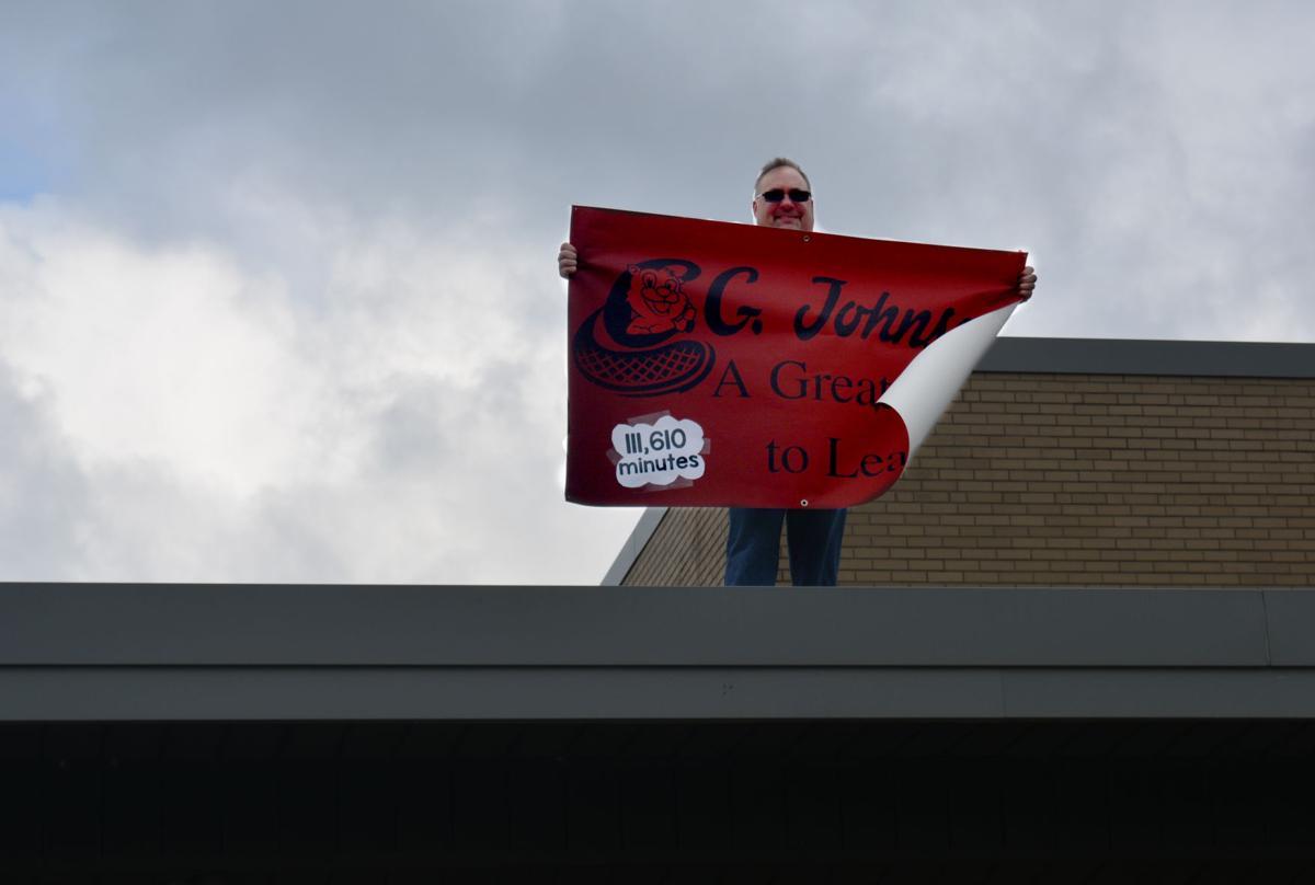 Dr. Edward Dombroski holding sign