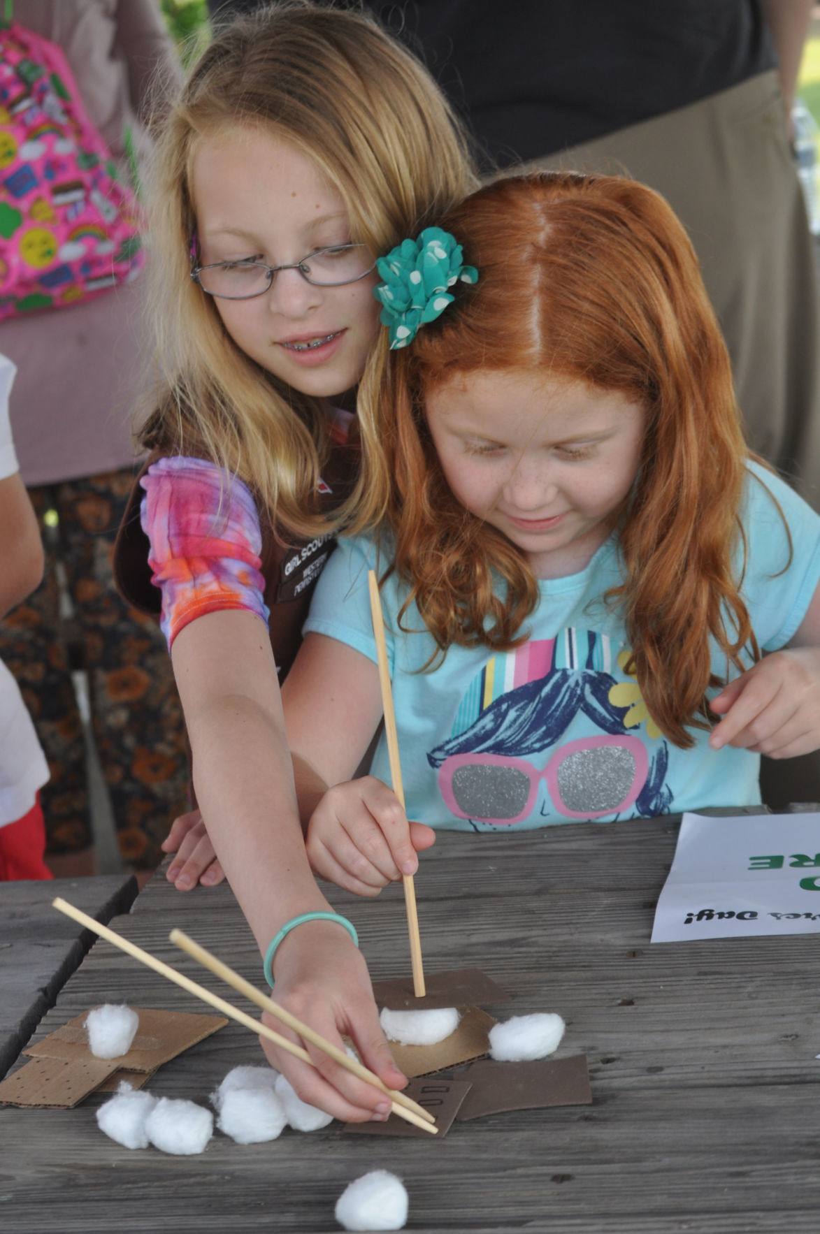 Girl Scouts make pretend s'mores