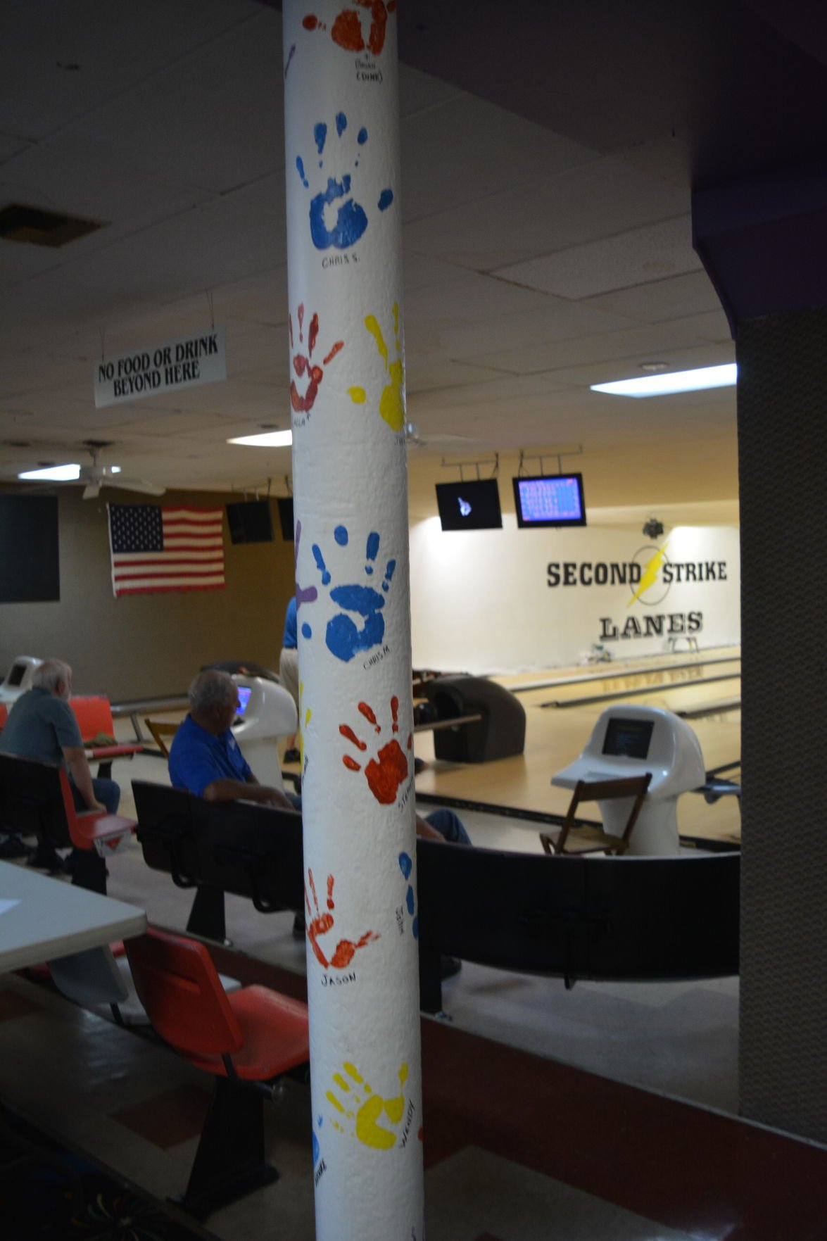 Helping hands at bowling alley