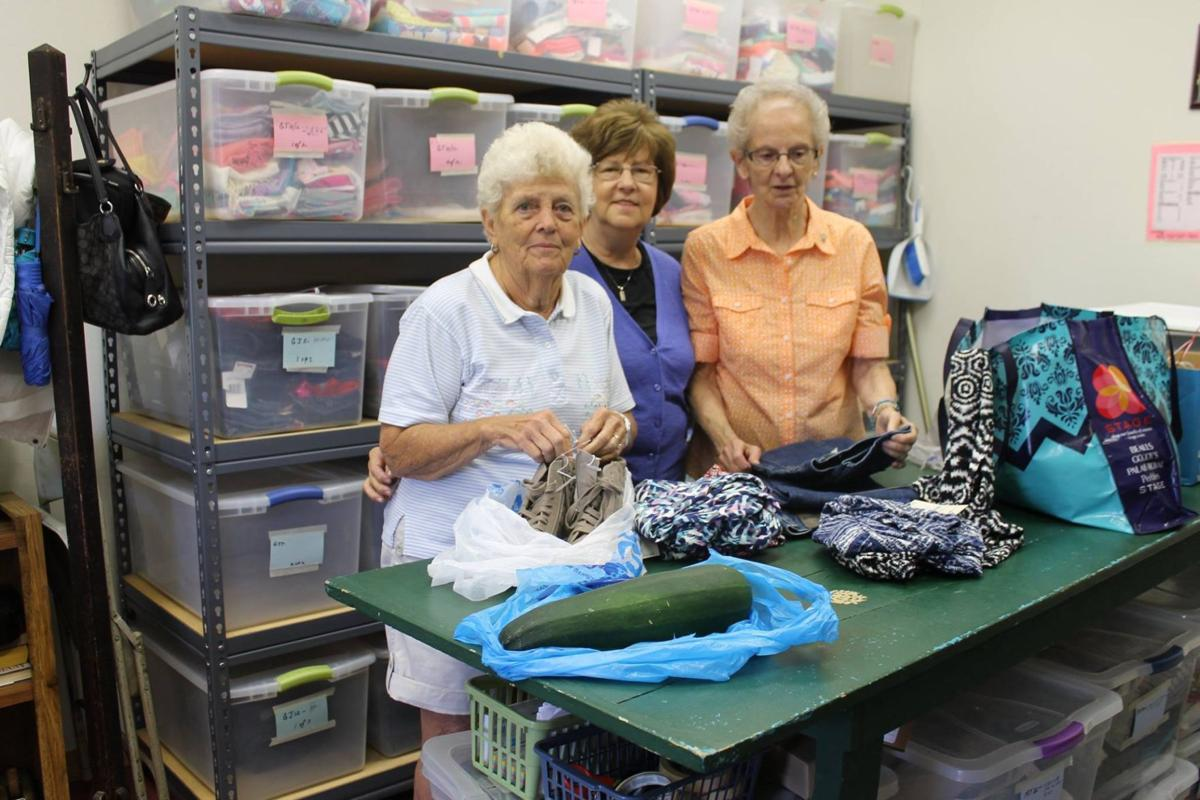 Volunteers organize clothing