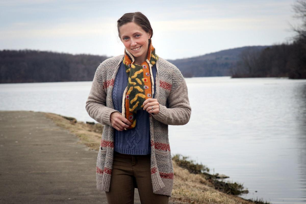 Artist shown with one of her felted scarves
