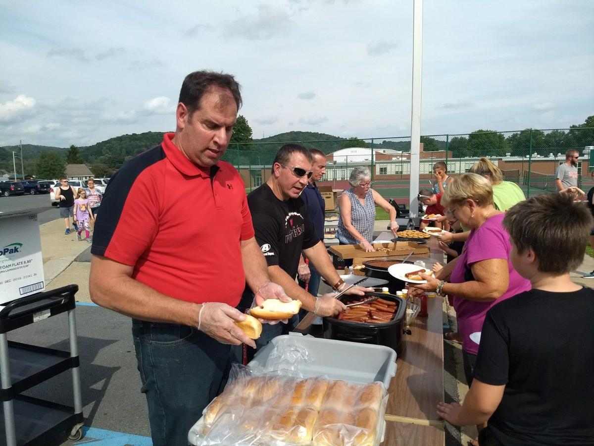 School leaders serve hot dogs