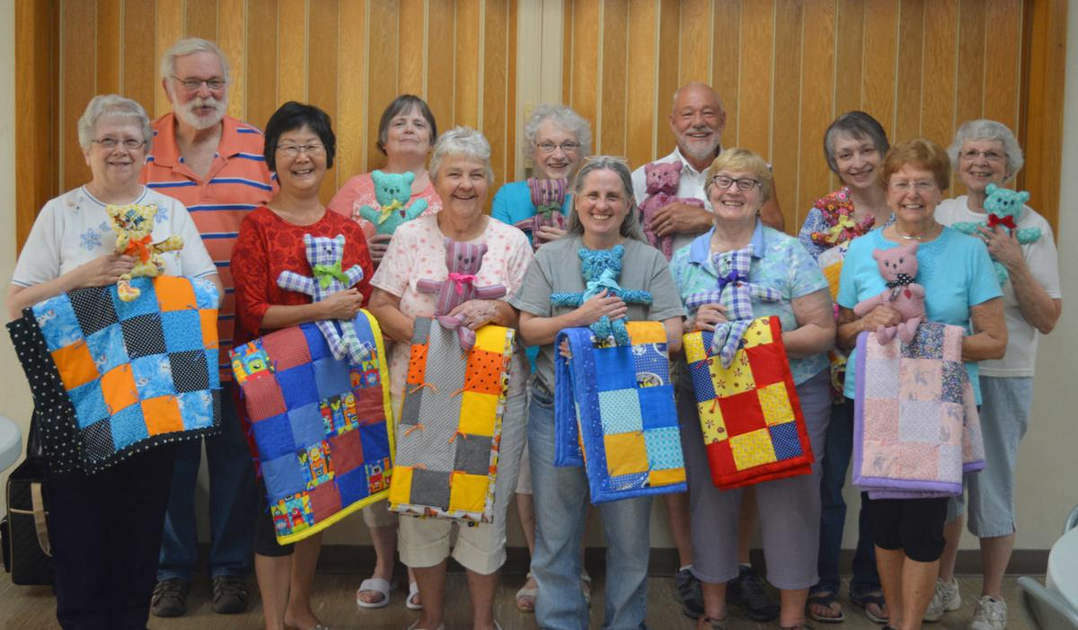 Group with quilts and bears