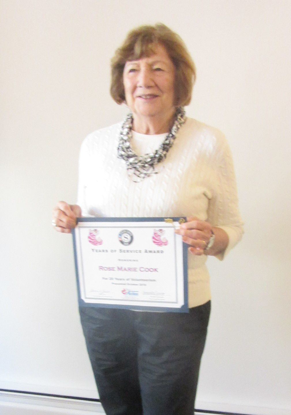 Cook receives certificate for 20 years of service