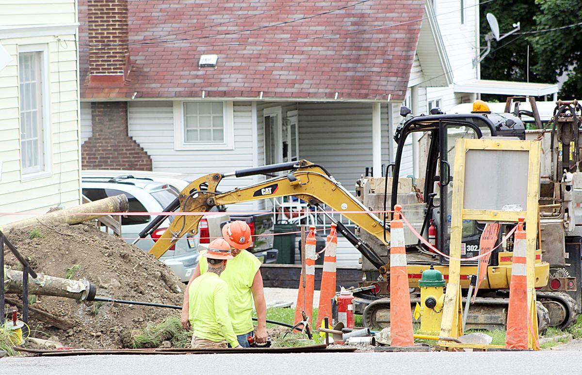 Contractors work on Main Street