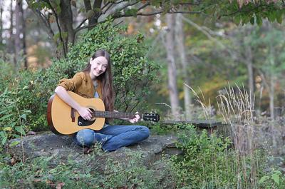 Mackenzie Lines and her guitar