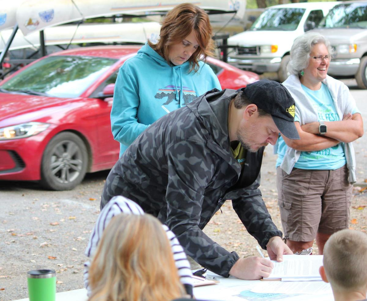 Registering for Clarion River clean-up event