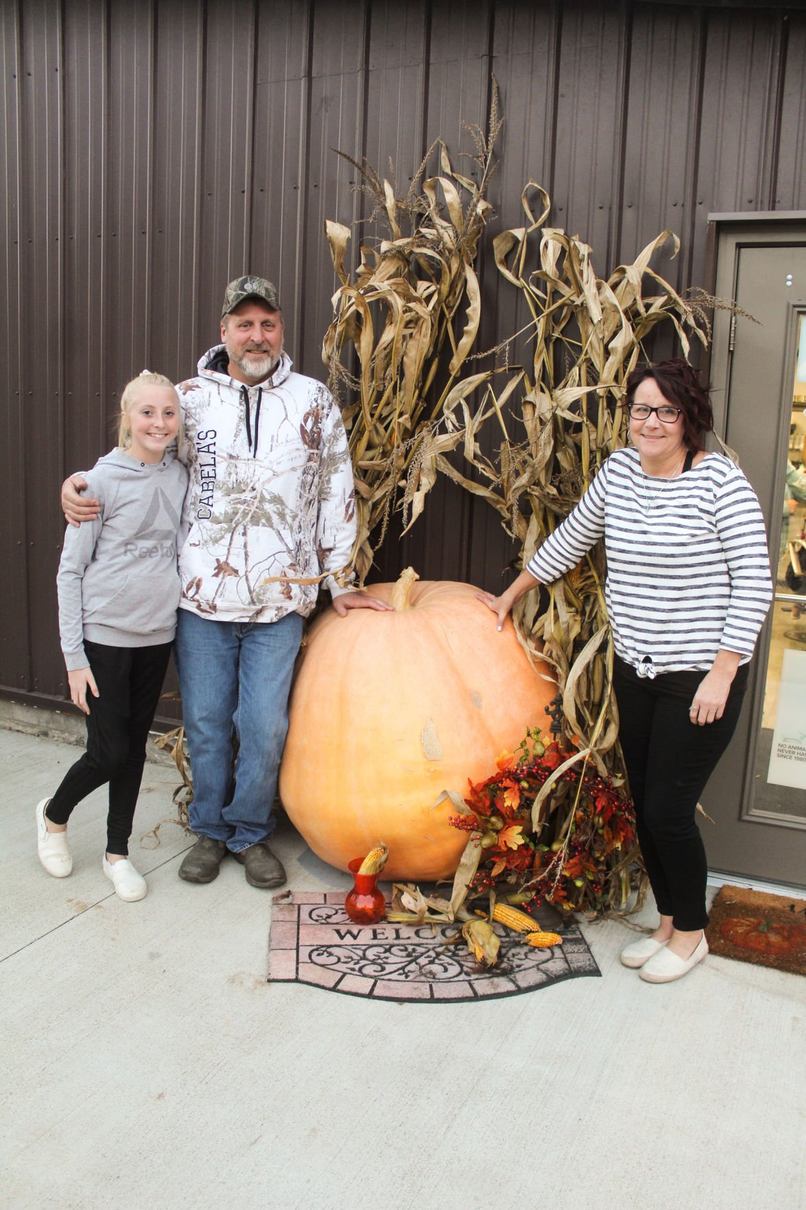 Family with pumpkin