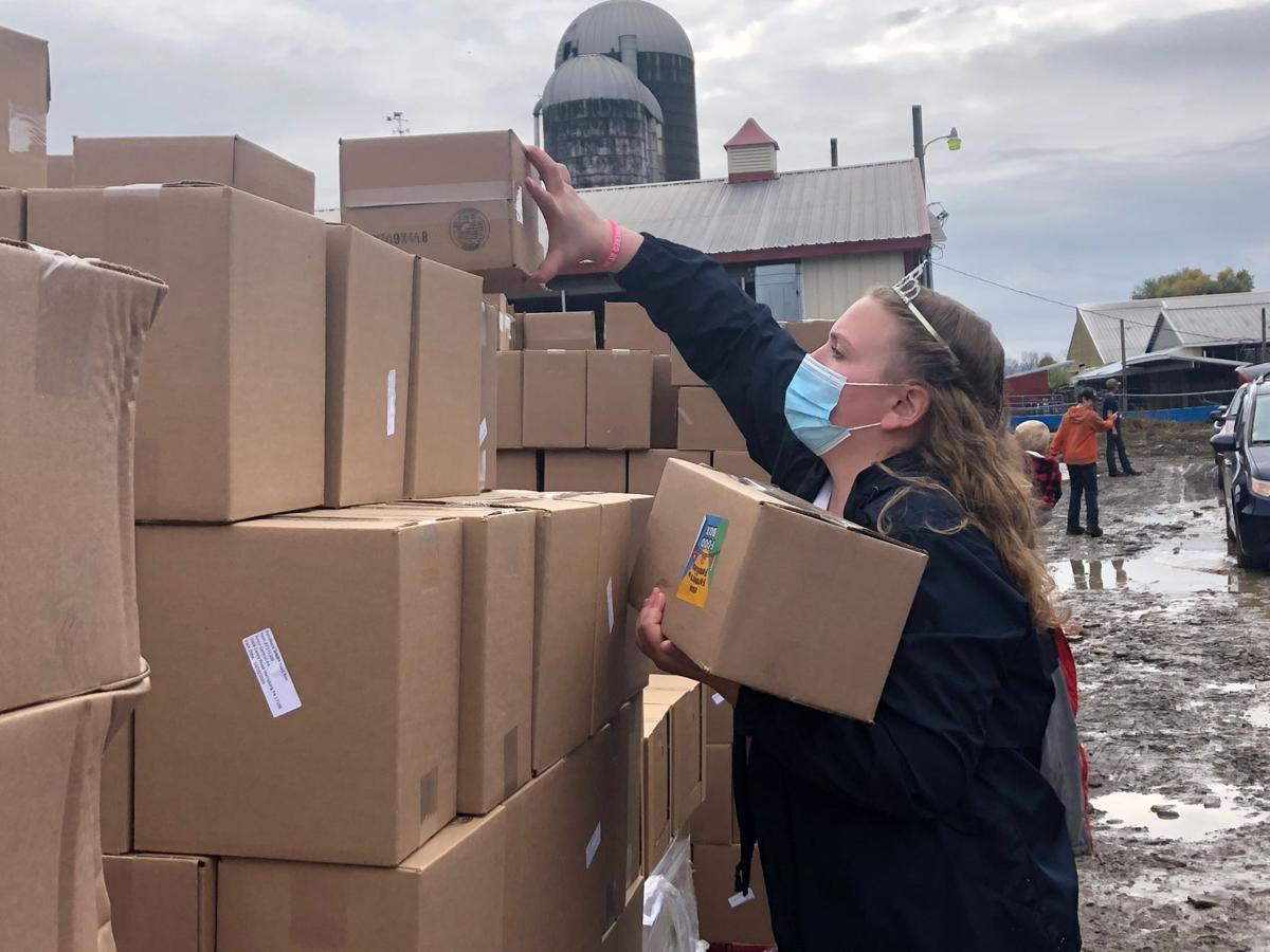 Dairy drive thru supplies residents with 27K pounds of food