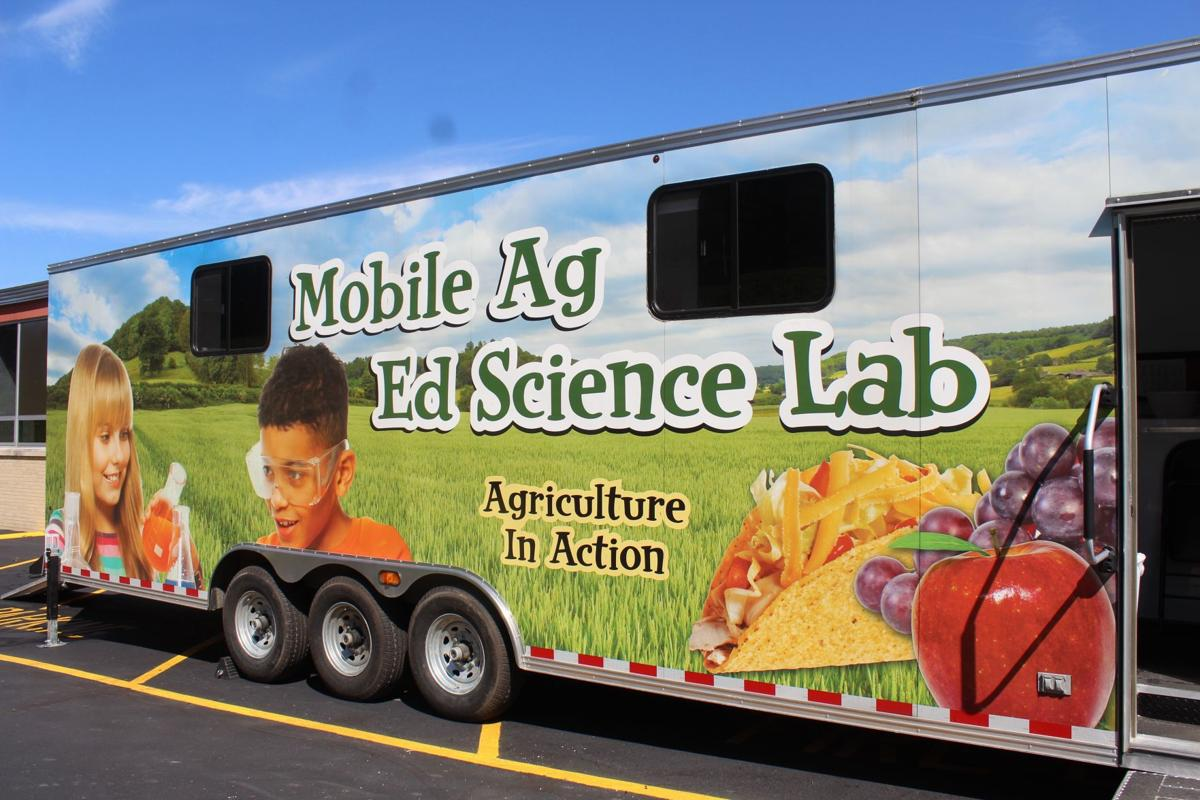 Planting seeds in Troy; Mobile Ag. Ed. Science Lab returns