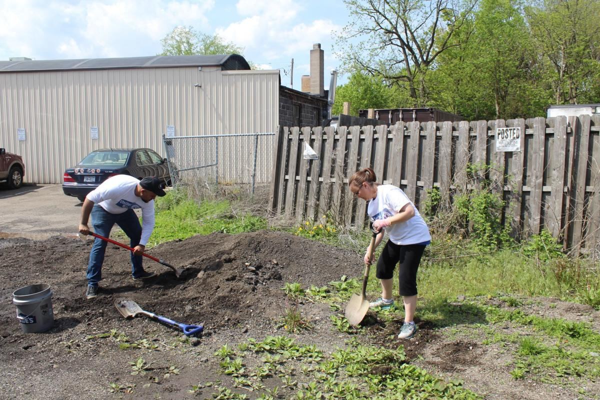 Members of food production, distribution partner for UW Day of Caring