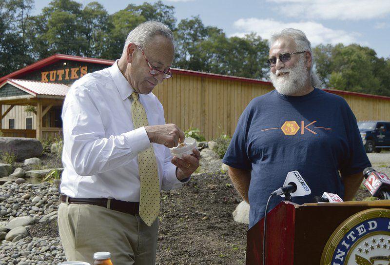 Senator visits beekeeper, blasts research cuts
