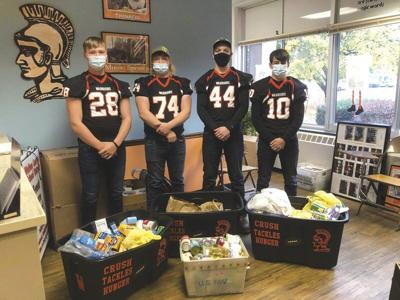 Walton football perseveres for food pantry