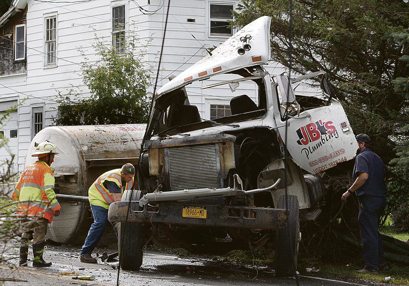Truck crashes, spills sewage near Meredith