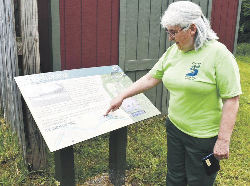 New trail signs memorialize pair of local citizens