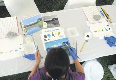 New Berlin art supplier treats employees to'Paint Day'