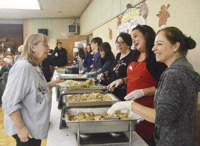Elks Club volunteers share Thanksgiving joy