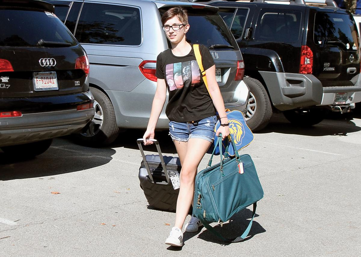 JoJo Prost carries her belongings into Copeland Hall at Maryville College