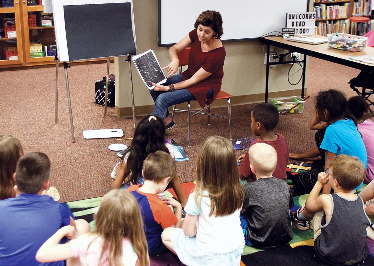 Alcoa Elementary School teacher Lisa Wigdor reads to campers
