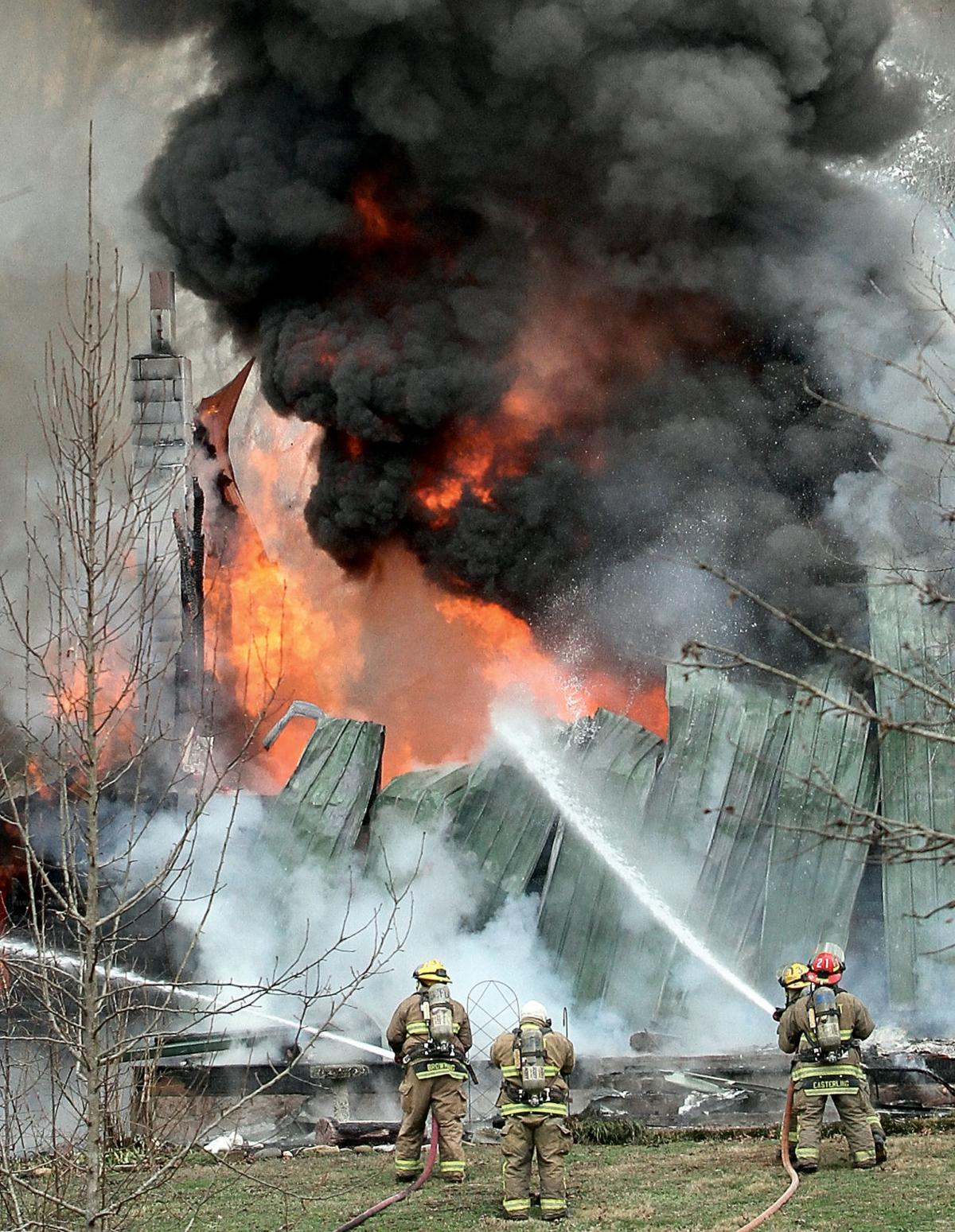Blount County fire fighters battle a fire on Reagan Mill Road