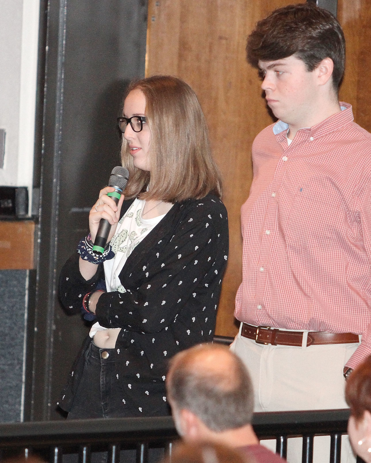 Erika Hill asks a question of Maryville High School alumni speakers