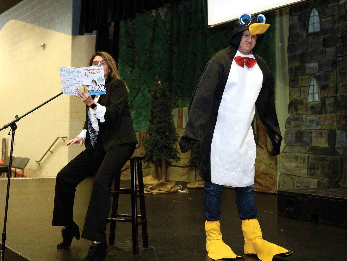 Coulter Grove Intermediate School teacher Andy Howe dressed as penguin for One Book Blitz