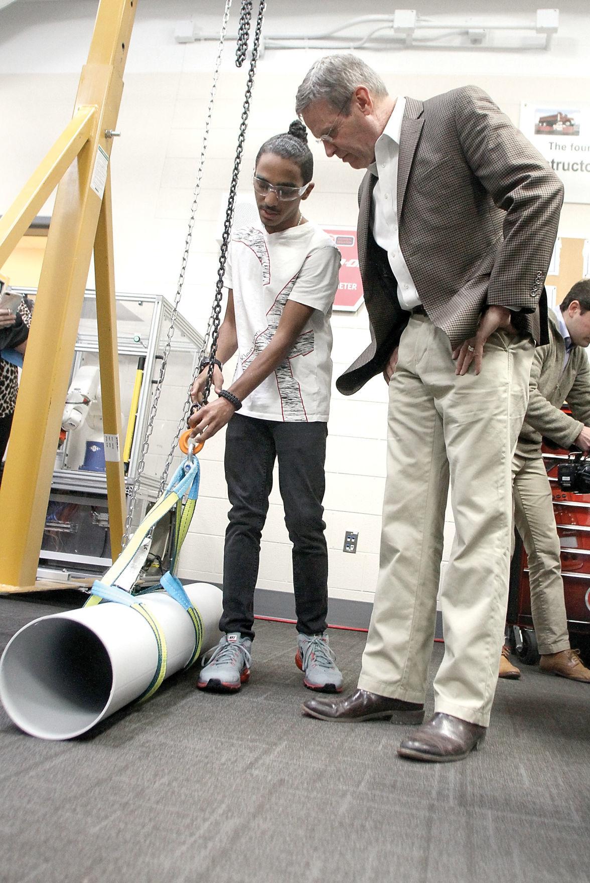 Alcoa High School student Chris Perez shows Gov. Bill Lee equipment in mechatronics lab