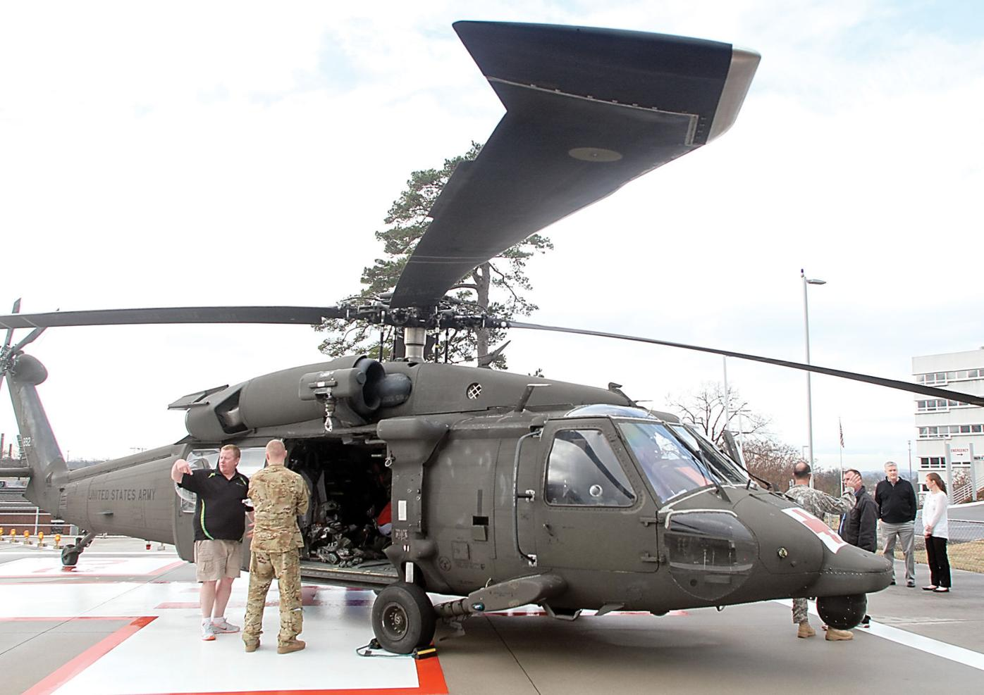 Blount Memorial Hospital employees check out the Black Hawk helicopter at the hospital