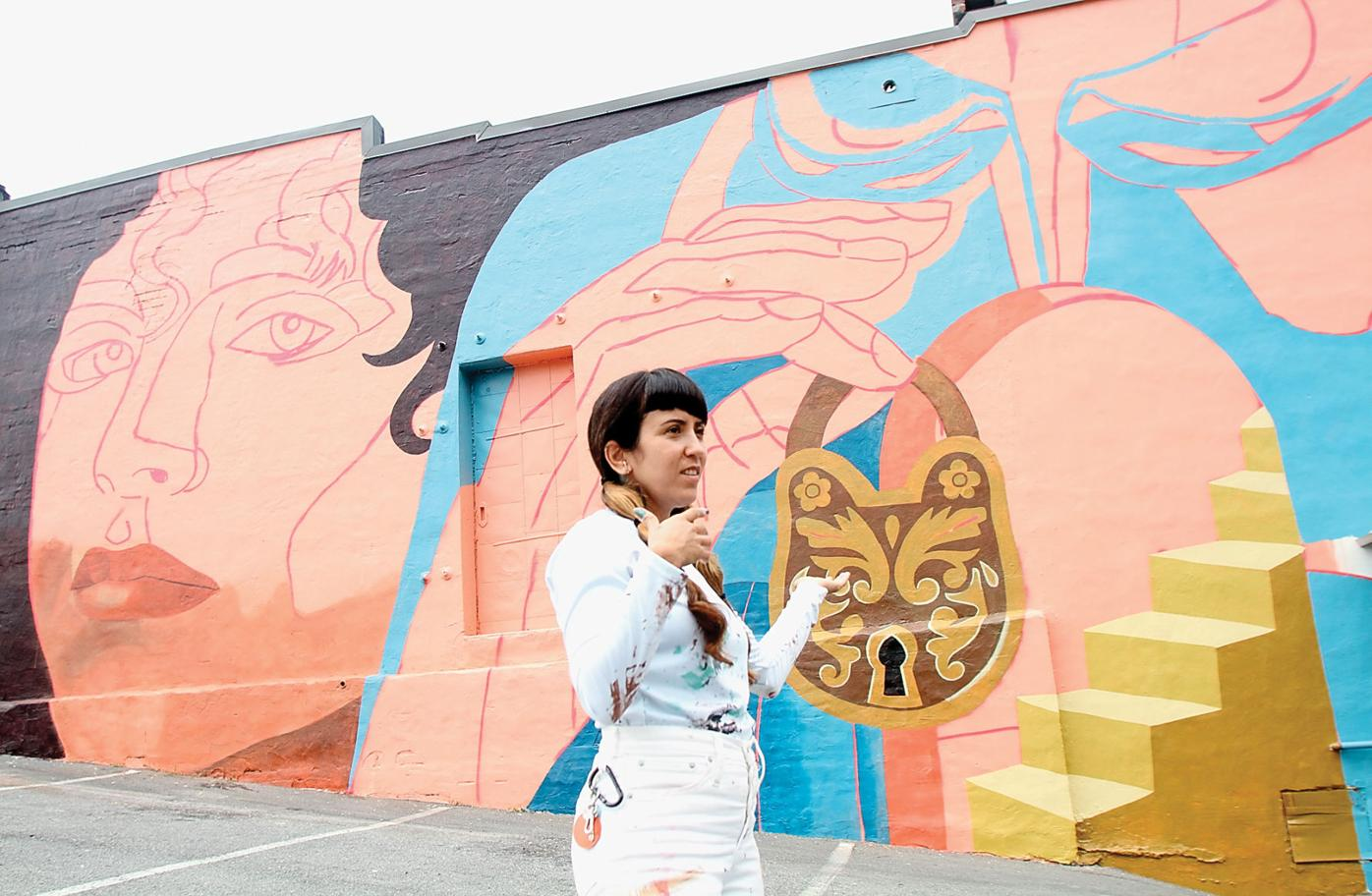 Artist Nicole Salgar talks about the inspiration for the mural she is painting