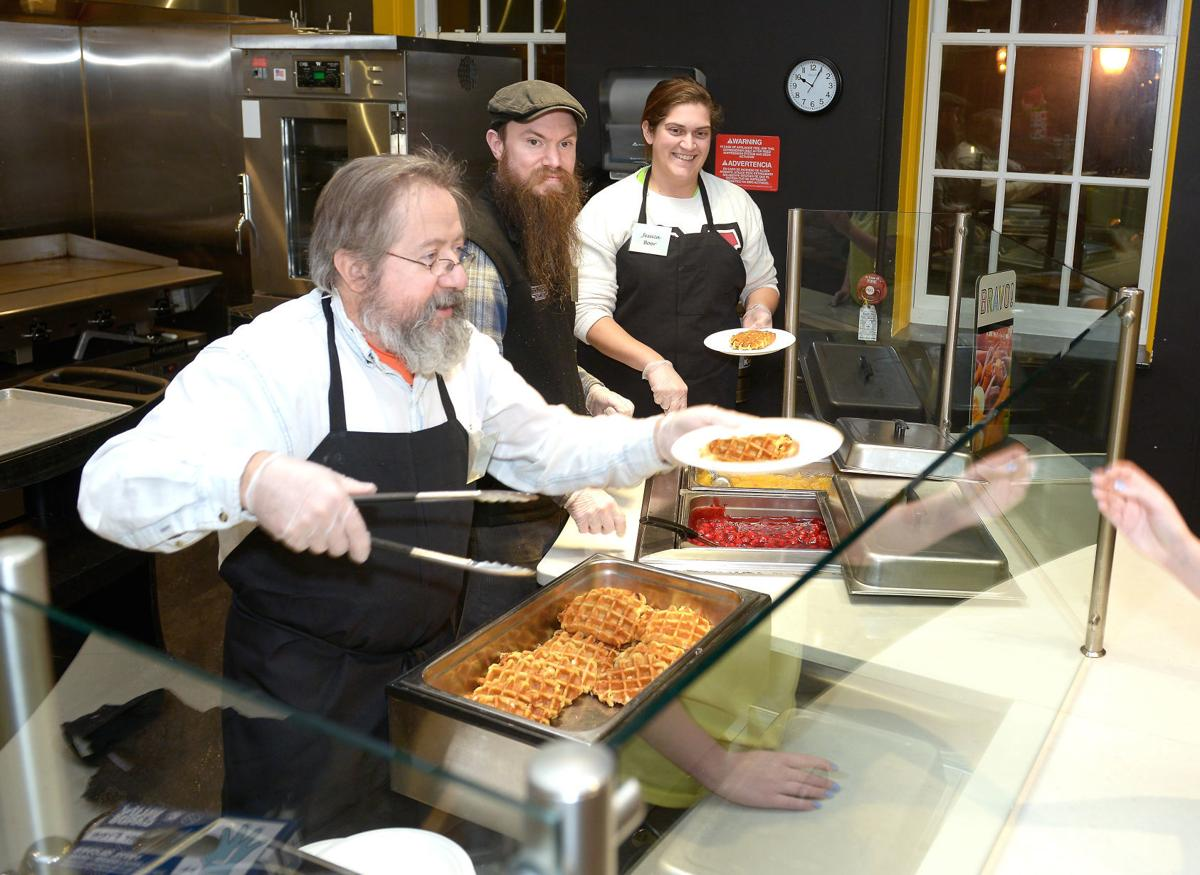 """Maryville College faculty and staff serve waffles during """"Finals Breakfast"""""""