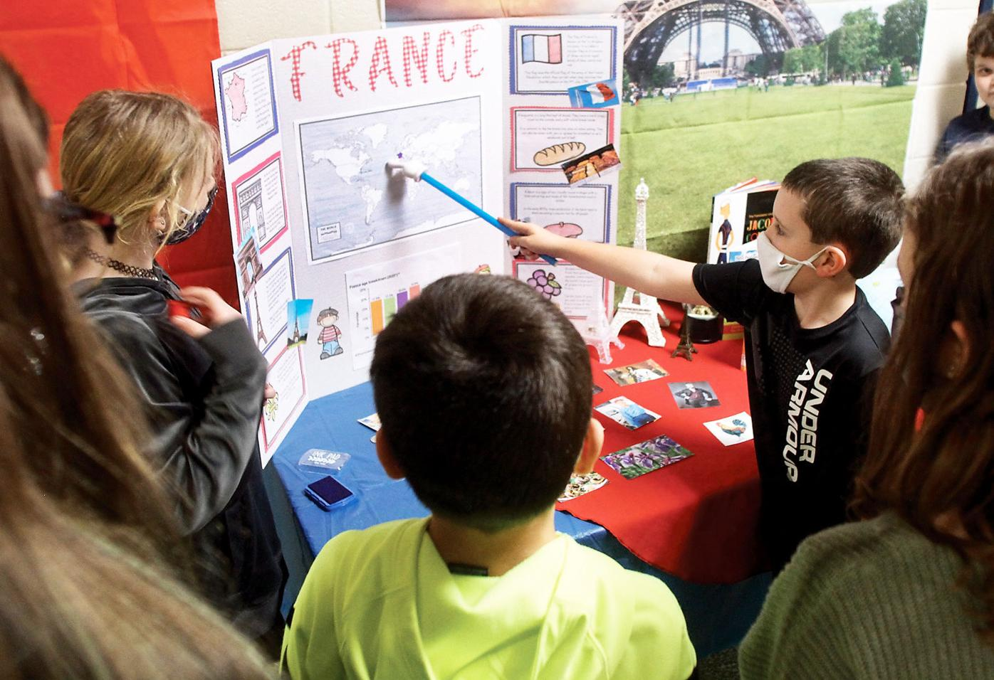 Middlesettlements student Gavin Newcomb teaches about France