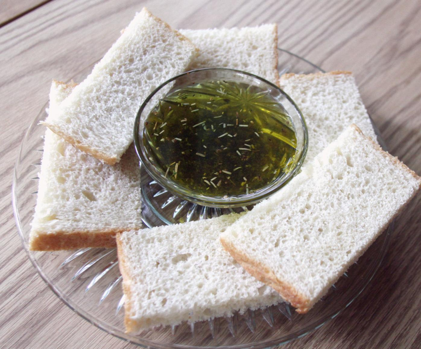 Olive oil with herbs for bread dipping