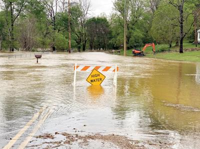 Flood waters cover River Ford Road (louisville)