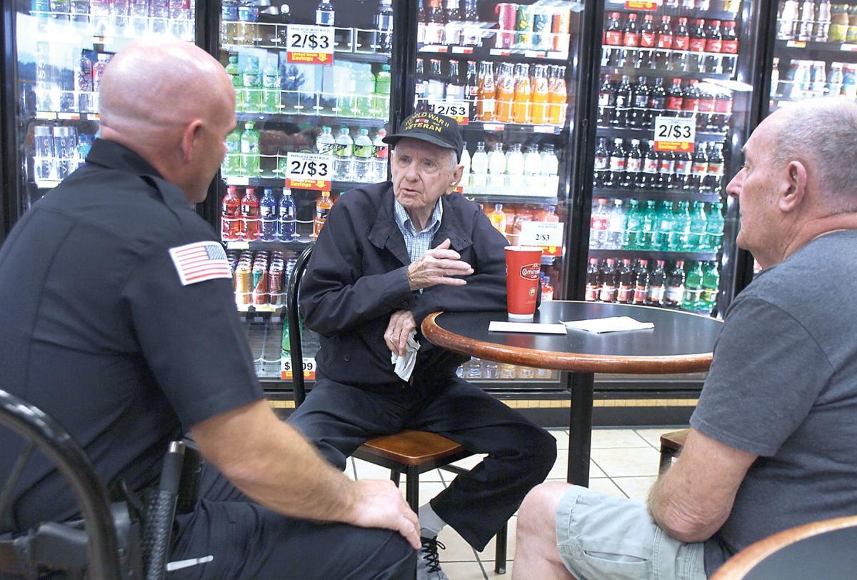Bernard Edwards talks with Police Chief Kevin Condee and Mayor Ron Palewski