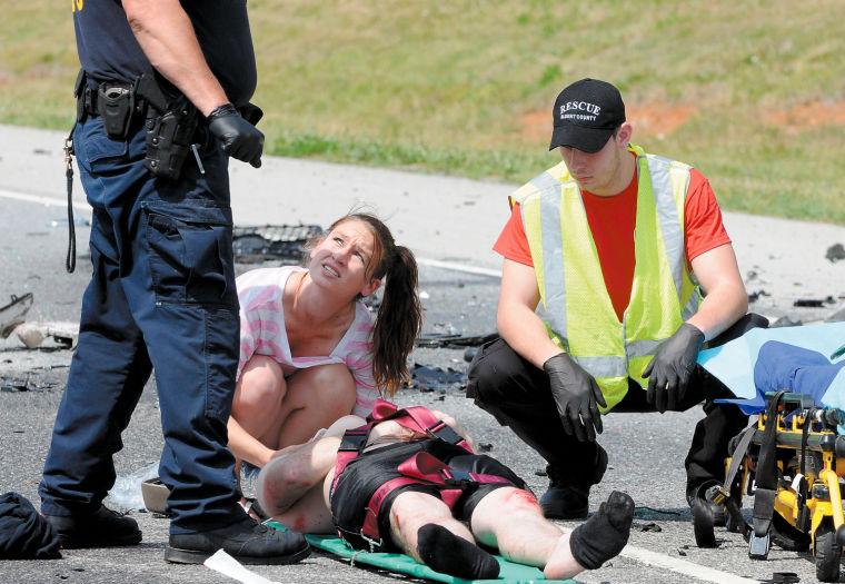 Woman comforts wreck victim