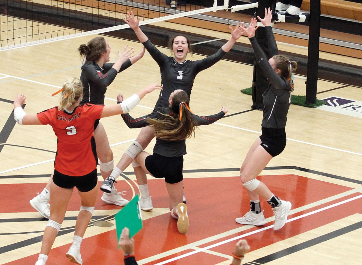 The Maryville girls volleyball celebrate