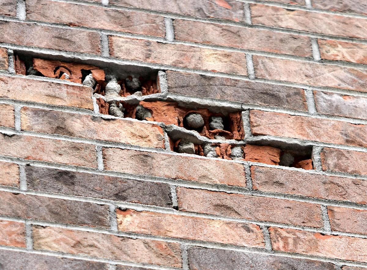Bricks along the roof at William Blount High School have started crumbling