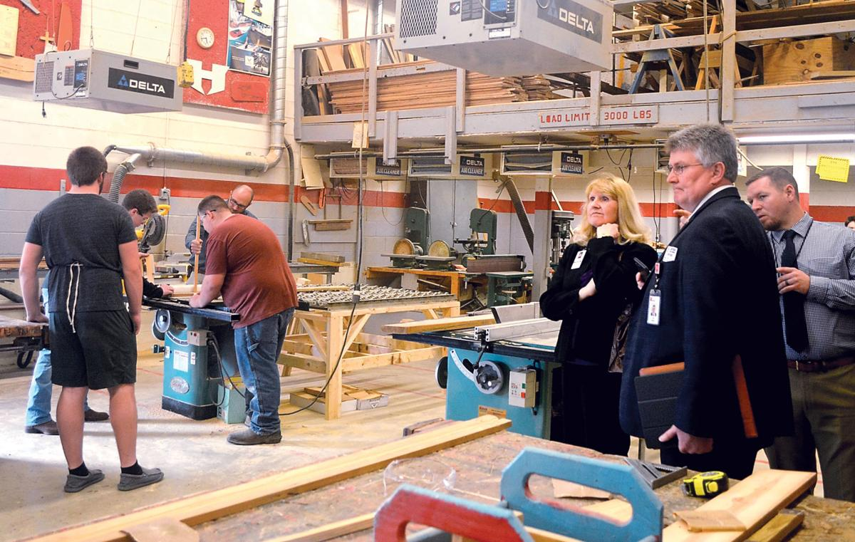 Deputy Education Commissioner Lyle Ailshie tours Heritage High School construction class