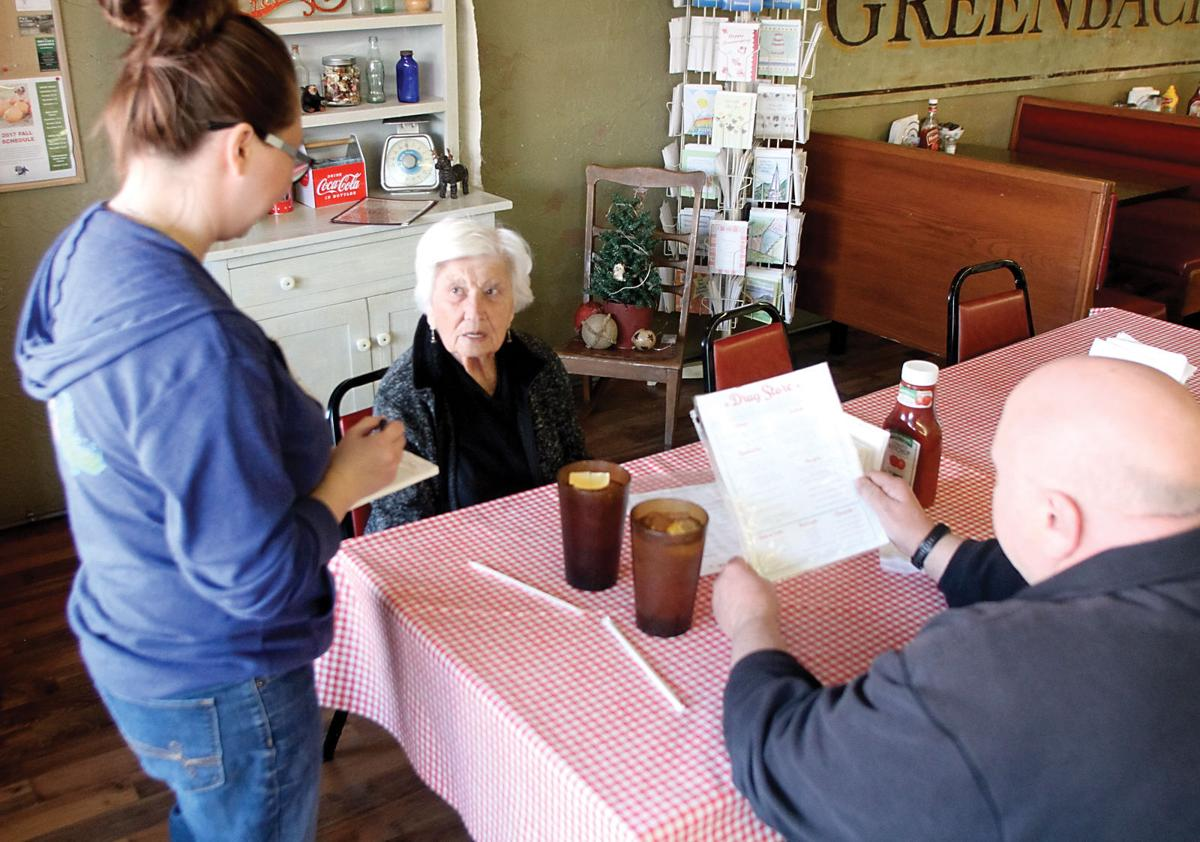 Cassie Tucker takes the food order from Jeff Tipton and Oveada Tipton at the Greenback Diner