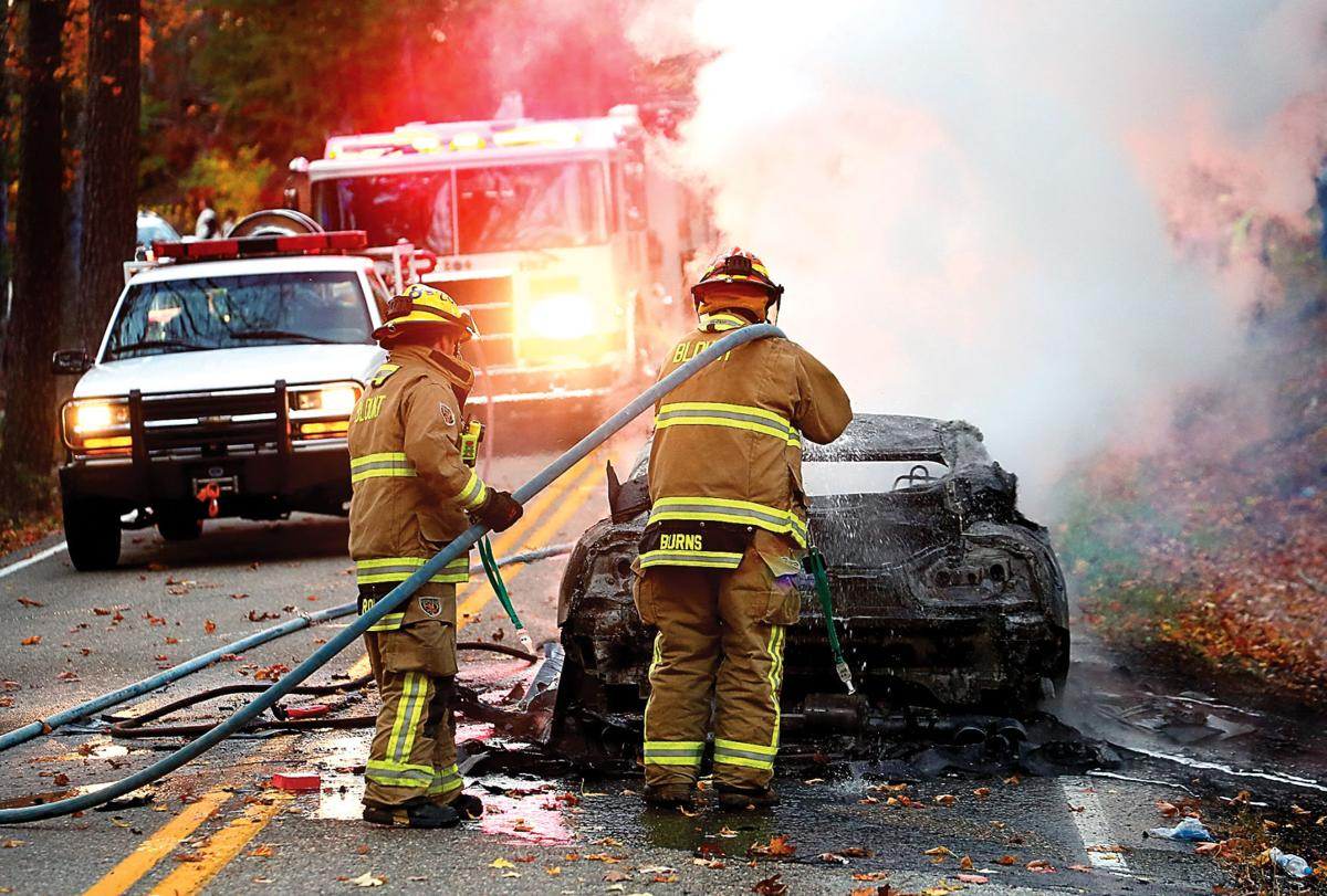Blount County firefighters extinguish a fire that destroyed a Nissan GT-R Premium on The Dragon