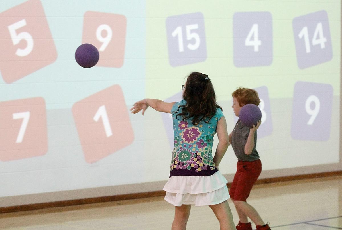 John Sevier Elementary School third-graders target math answers on the Lü interactive playground