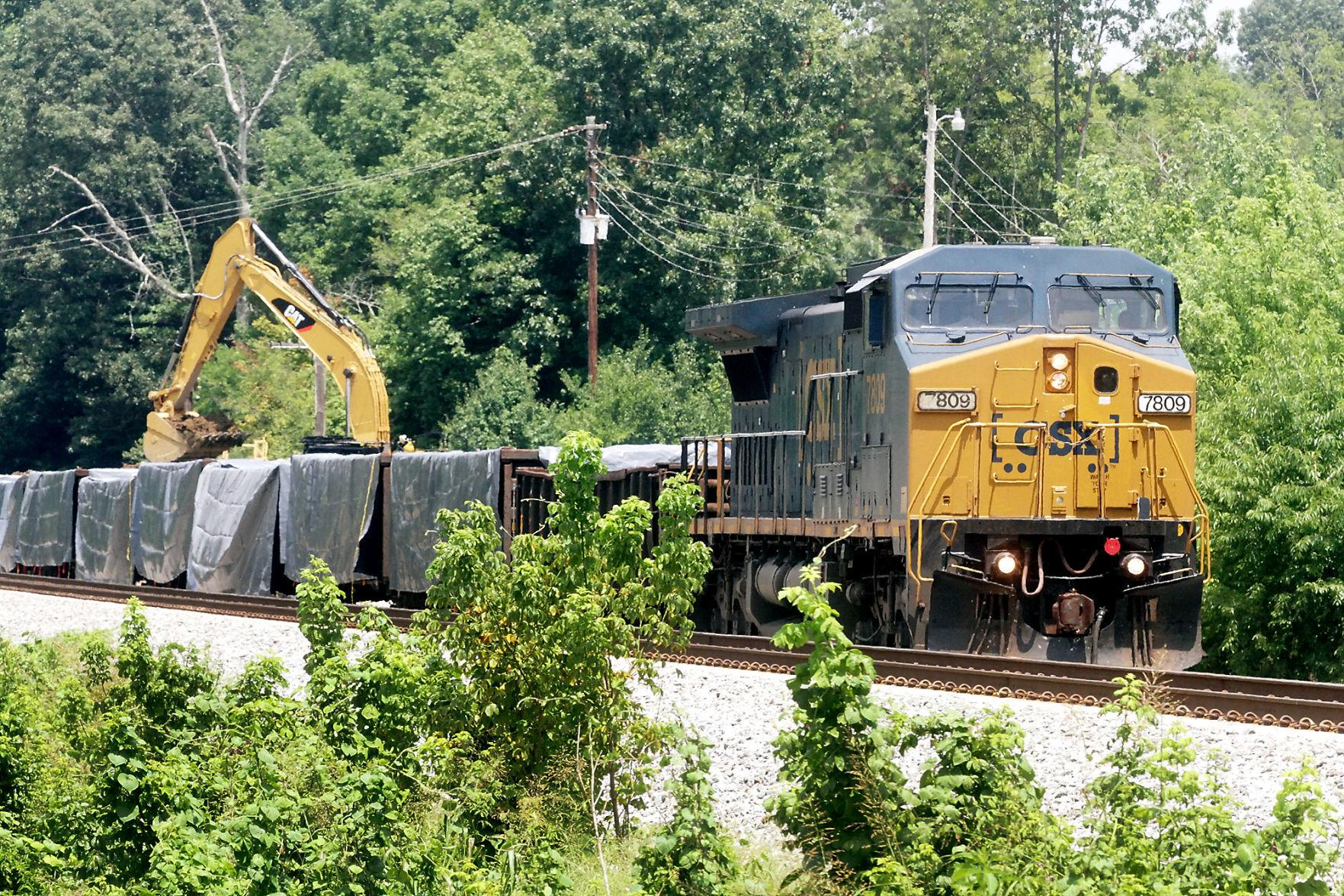 CSX loads excavated soil from train derailment — suits