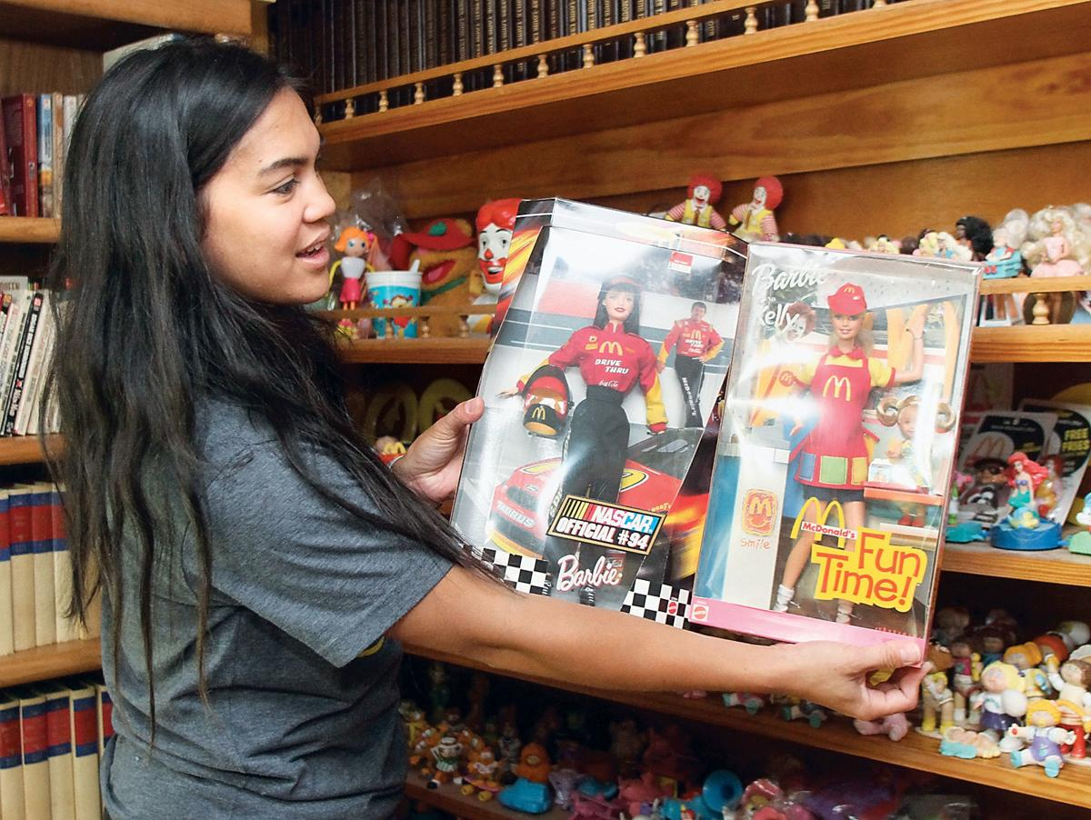 Roben Richmond shows two McDonald's dolls