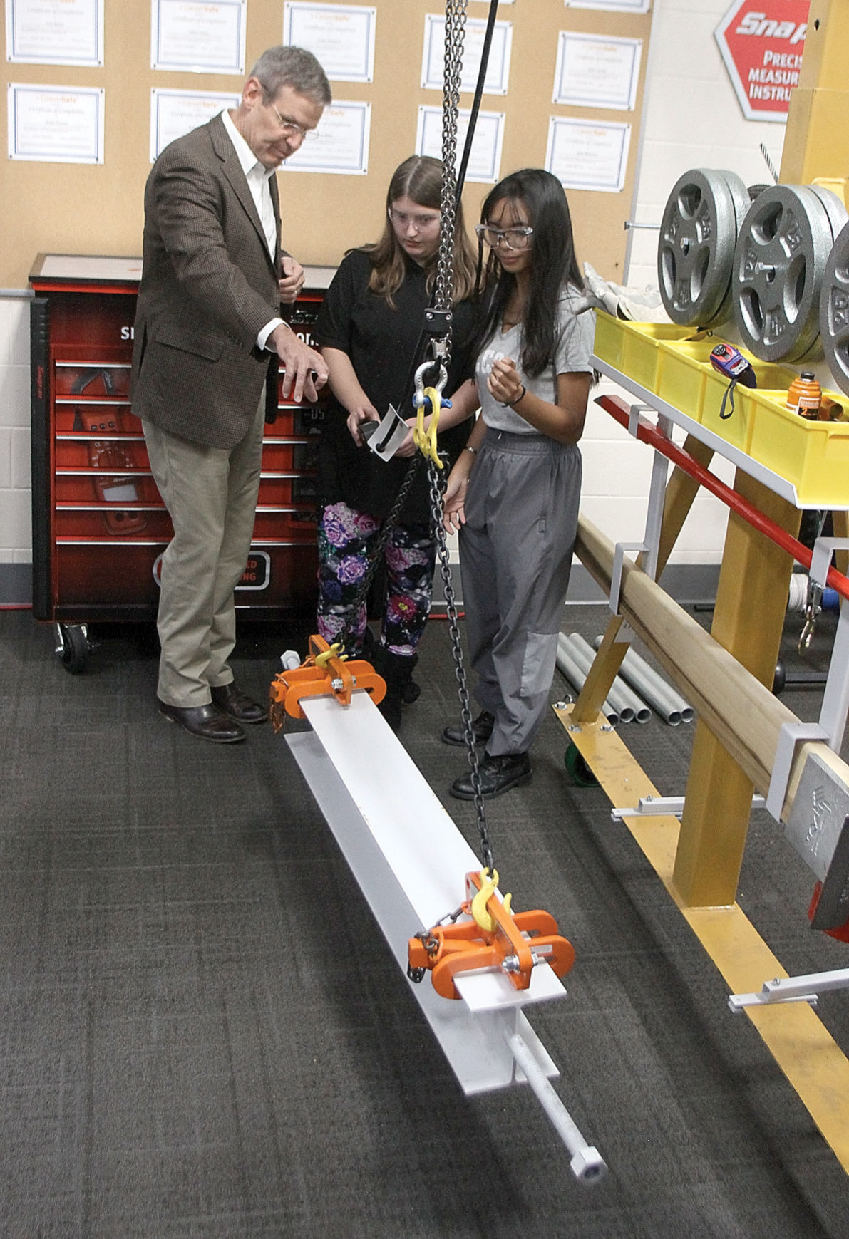 Gov. Bill Lee talks with Samantha Townsend (center) and Denise Butial in Alcoa High School's mechatronics lab