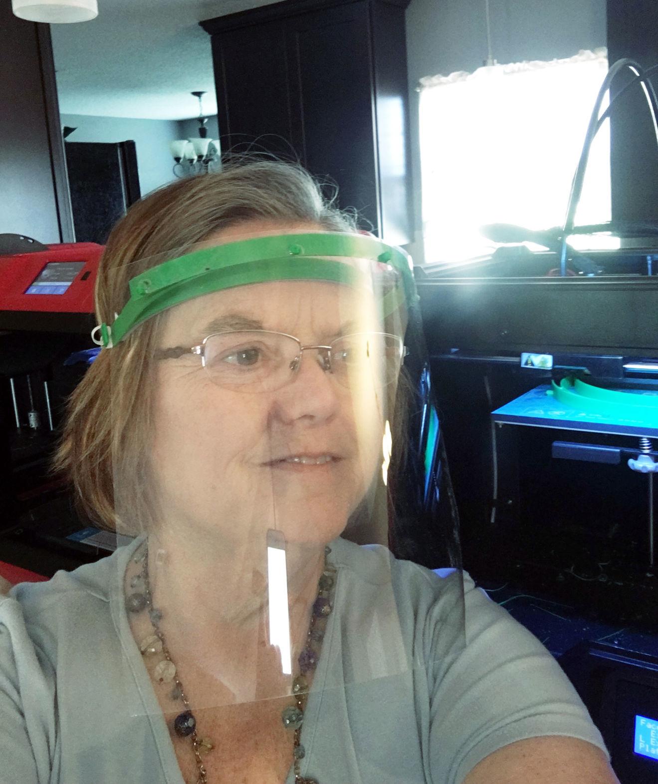 Lanier Elementary School teacher Renee Powell wears face shield