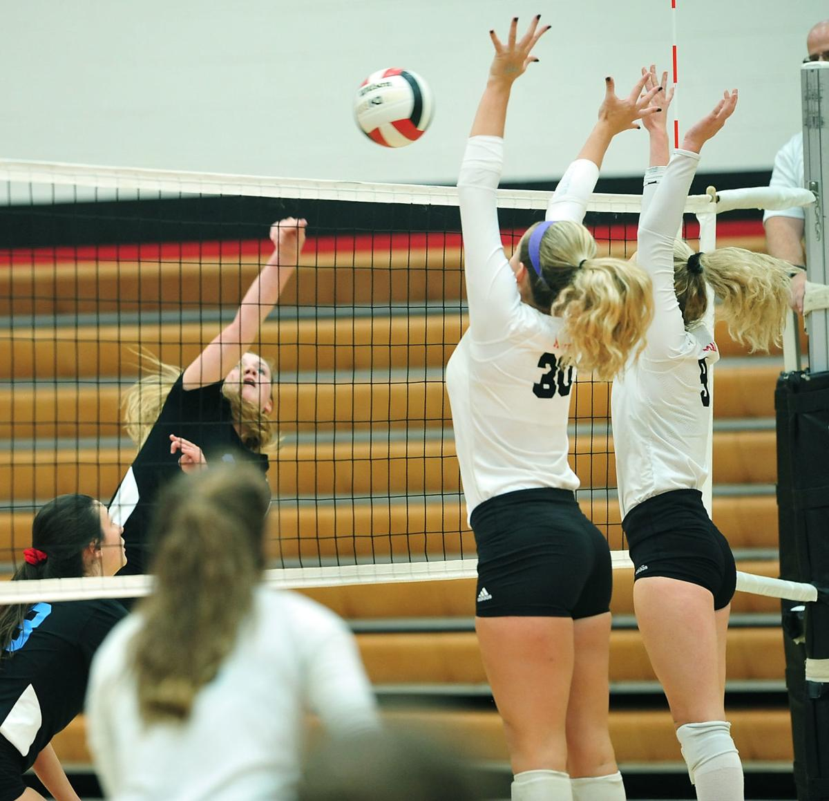 VOLLEYBALL: Heritage's Emma Whitehead and Maryville's Meg Mersman and Delaney White