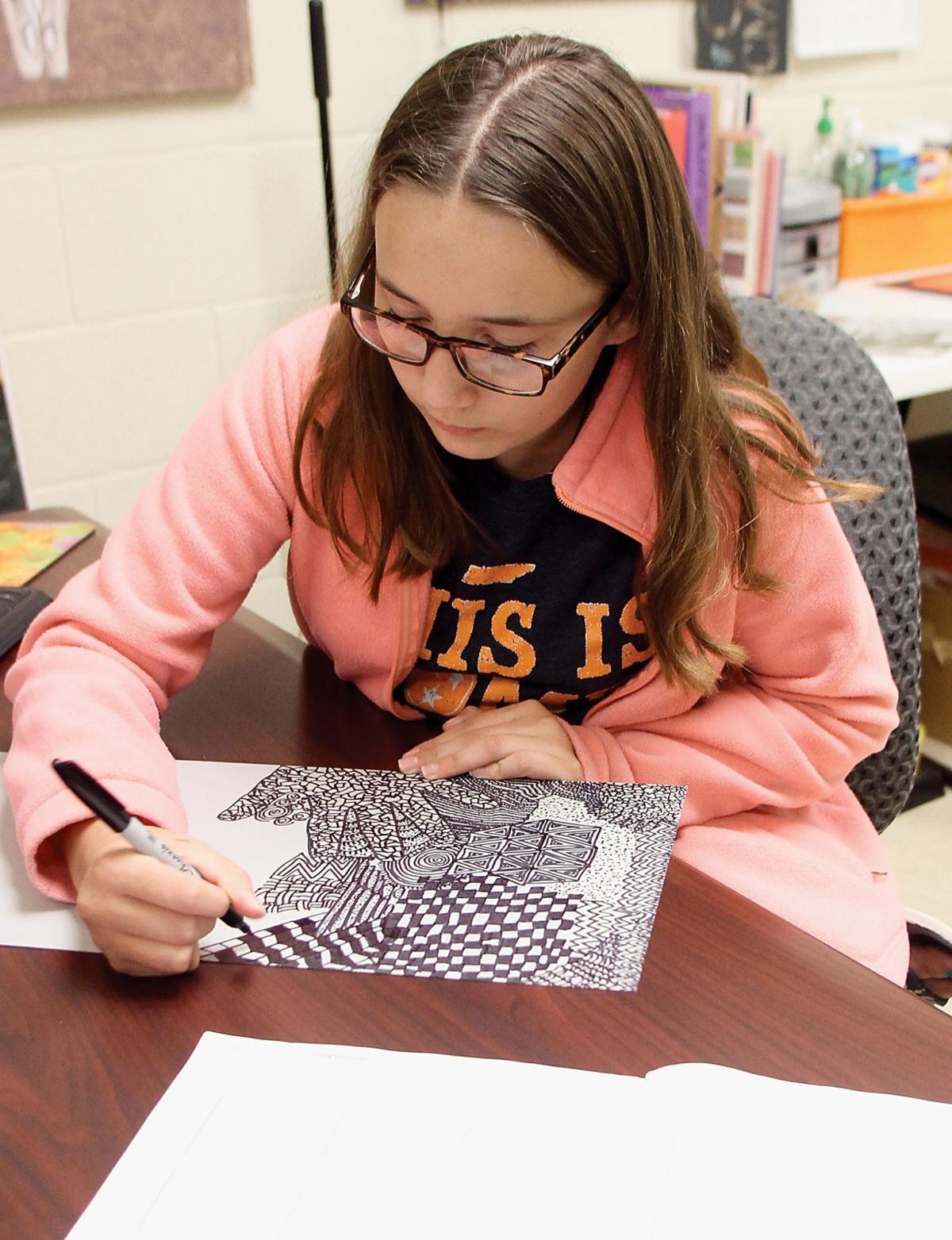 Zoey Kirkland draws Zentangles at Carpenters Middle School
