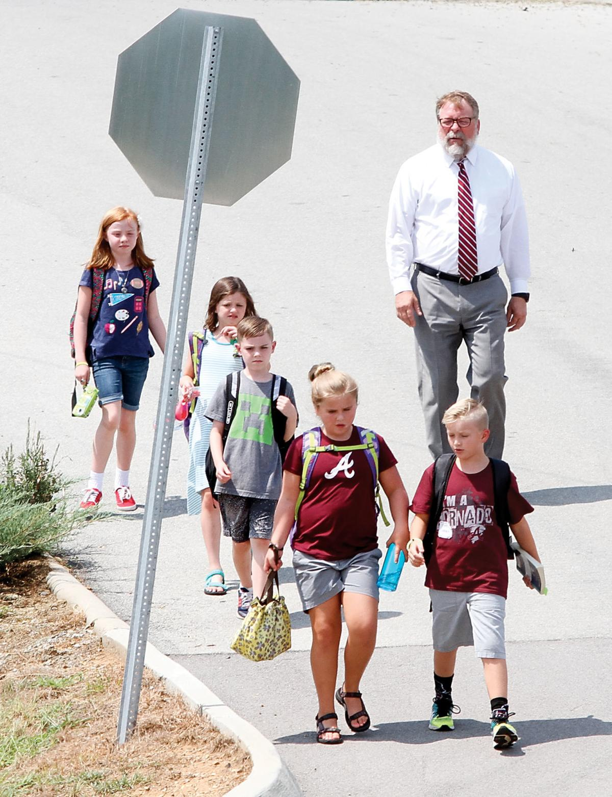 Brian Bell leads children from Alcoa Intermediate School to the high school