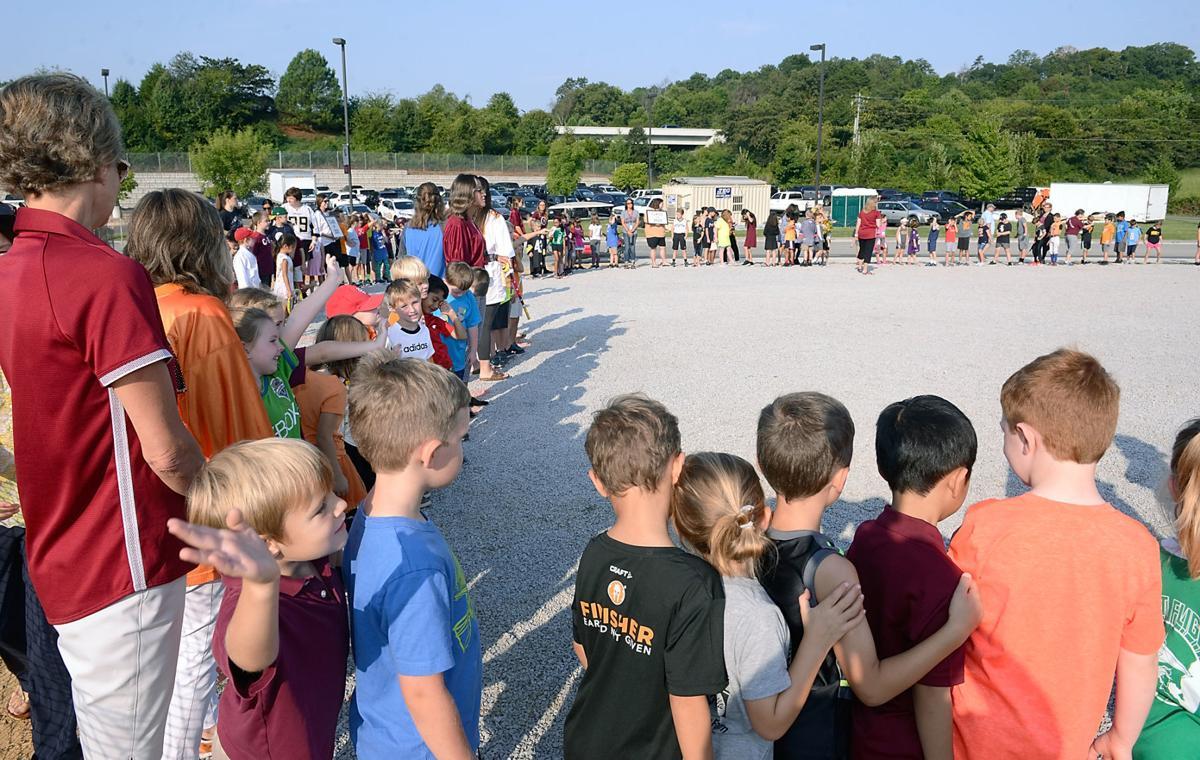 Clayton-Bradley Academy students line perimeter of new Student Union